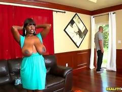 Chimille Morgan was in the middle of ironing her clothes when Jmac dropped by. Busty black slut drops what shes doing to let him fuck her senseless and cum all over her huge tits!