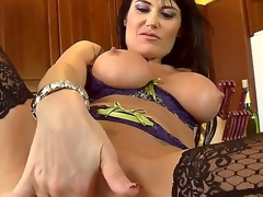 This French mama with huge tits is a real sex freak! She looks gorgeous in her sexy lingerie and her pussy is already soaking wet. After playing with herself she goes down on a palpitating cock.