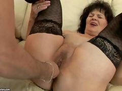 Naughty granny Helena May in darksome stockings gets her pussy and asshole toy drilled by her curious fuck buddy before he inserts his hard pecker in her vagina. Watch older woman get pleasure