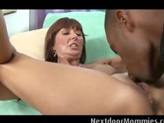 Mature woman takes a plump black cock