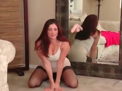 Solo redhead milf Alicia Silver in darksome pantyhose