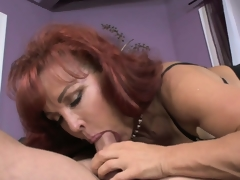 Mature redheaded mother in law receives a lusty pussy licking from her new son