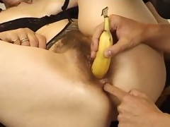 Mature takes banana and his 10-Pounder in her pussy